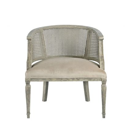 antique grey armchair with caned frame and velvet seat
