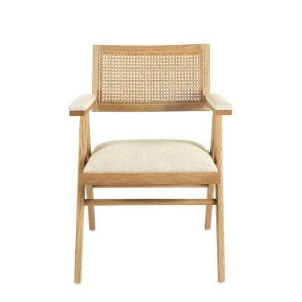 A stylish, scandinavian-inspired upholstered armchair with a caned back rest