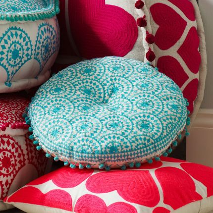 Round embroidered turquoise bohemian patterned cushion