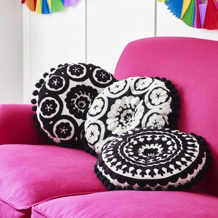 black and white round embroidered cushion