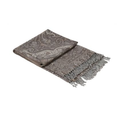A 100% wool throw with a elaborate floral scroll pattern