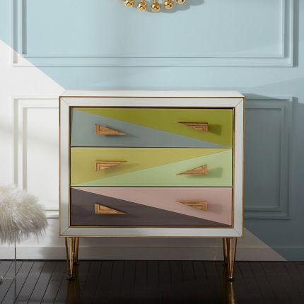 A modern Italian-inspired chest of drawers with angular hardware and brass accents