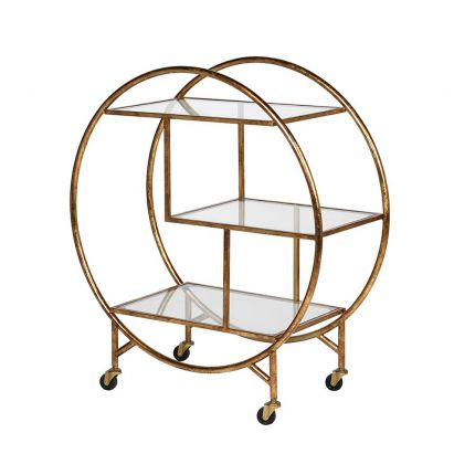 an antiqued round gold drinks trolley with glass shelves