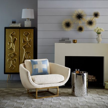 modern luxe armchair with ivory boucle upholstery and polished brass base