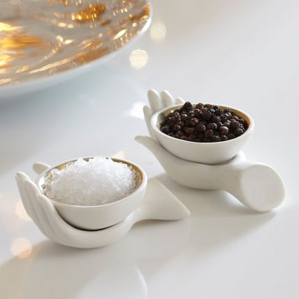 a pair of stylish matte porcelain and gold salt and pepper cellars