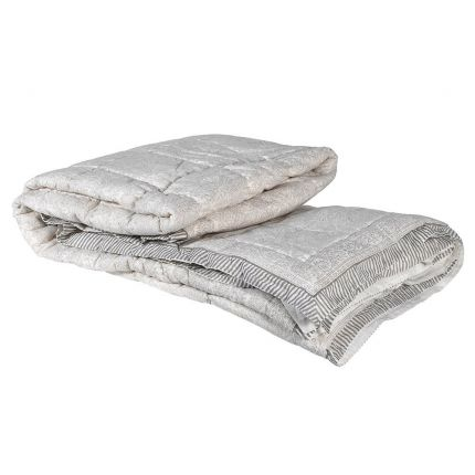 A luxurious, super-king grey paisley bedspread