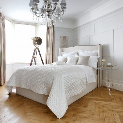 Luxury, French-style bed with small wings and French studding on a sprung slatted base
