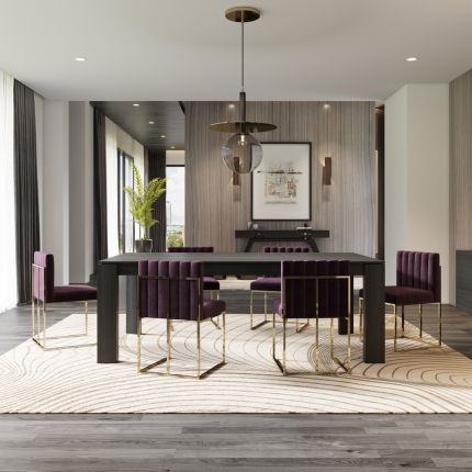 A luxurious velvet armchair with a fluted back and a glamorous golden frame. Pictured in Vienna Purple.