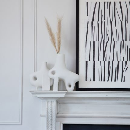 Matte porcelain decorative sculpture with smooth and rough textures