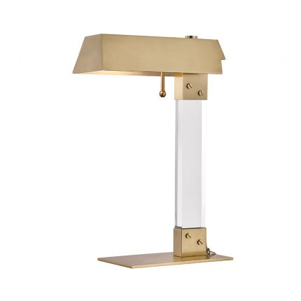 A timelessly elegant aged brass and acrylic table lamp
