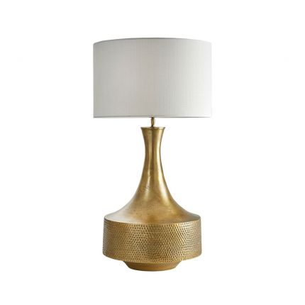 An elegant antique brass engraved table lamp with an off-white shade