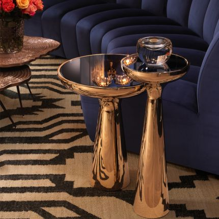 Sleek low gold side table with black glass table top