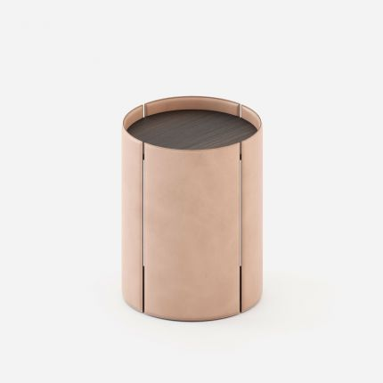 A luxurious side table with leather upholstery and a matte, black ash table top