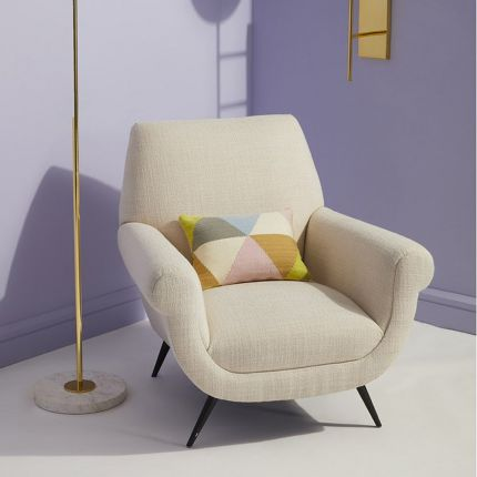 A luxurious natural-toned armchair with black tapered legs
