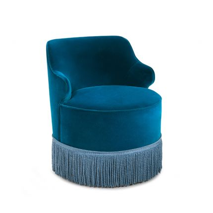 A stylish vintage-style armchair with a fringed skirt