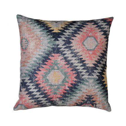 a colourful Aztec zig-zag patterned cushion with a distressed look