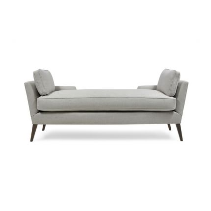 A stylish modern bench with cushions and wooden feet