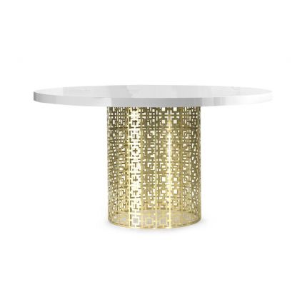A stylish polished brass table with a lattice cutout design and a round tabletop