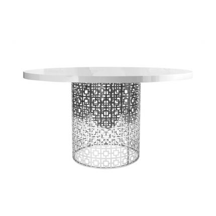 A glamorous dining table with a polished nickel base and a glass, marble or white gloss tabletop