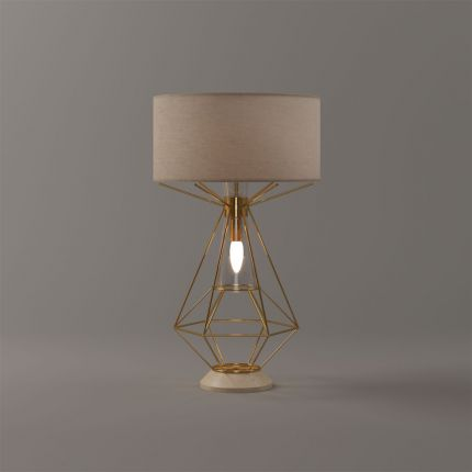 A glamorous geometric brass table lamp with a linen lampshade
