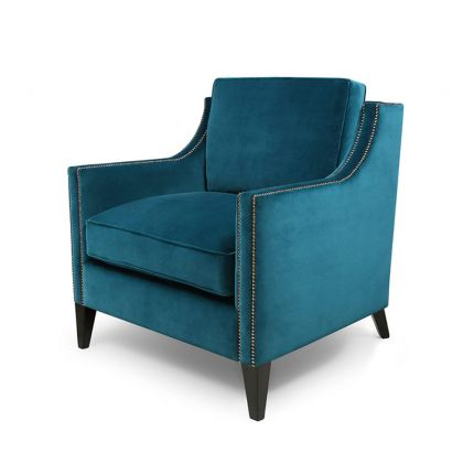 An elegant and cosy armchair with bronze studding
