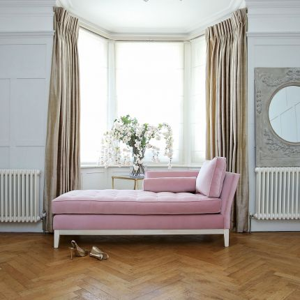 Luxury lounge, chaise longue with soft lined design and a bolster cushion
