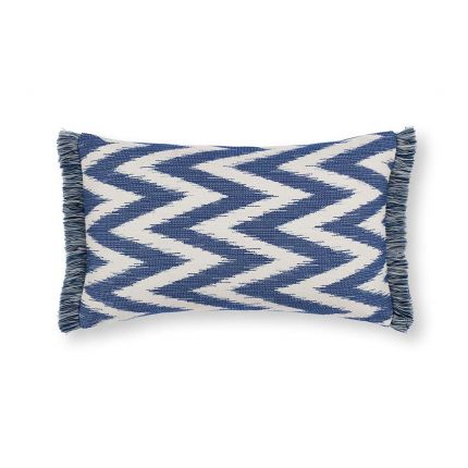 A gorgeous rectangular cushion with a blue and cream zig zag pattern, adorned with a fringe.