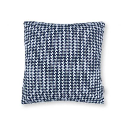 A blue houndstooth knitted outdoor cushion