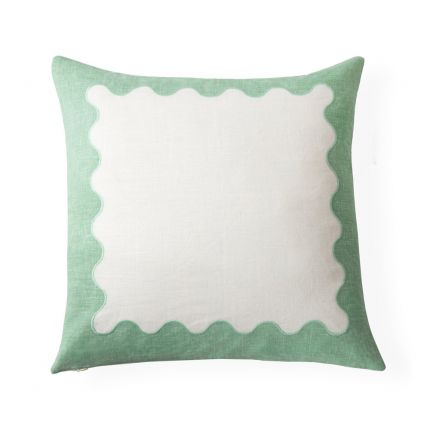 a stylish two-toned green and white ripple embroidered cushion