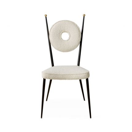 A fabulous cream boucle and blackened steel dining chair