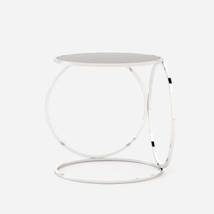 A luxurious stainless steel table with a clear, glass tabletop