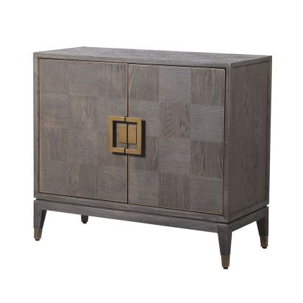 A luxurious 2 door cabinet with interior shelving and antique brass accents