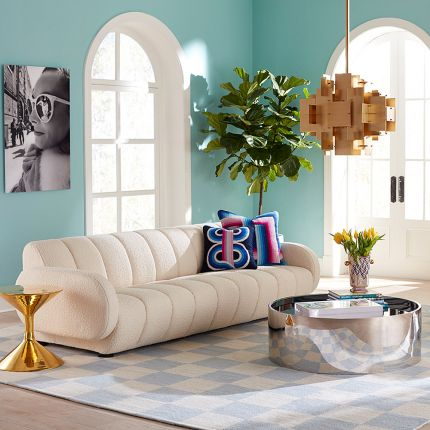 modern sofa with cream, boucle upholstery