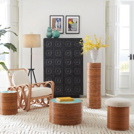 A luxurious cream boucle topped rattan stool