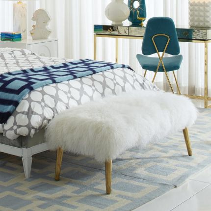 A lavish, white Mongolian bench with polished brass legs