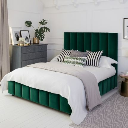 Art deco chic style bed with a towering deep fluted panel headboard