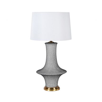 A luxurious table lamp with a white linen shade