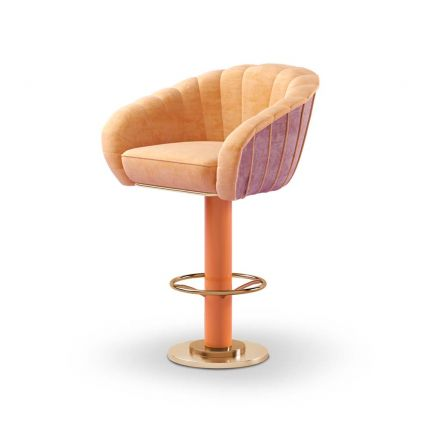 A swivel bar chair with fluted details and brushed brass base.