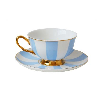 A chic blue and white striped teacup and saucer with golden accents