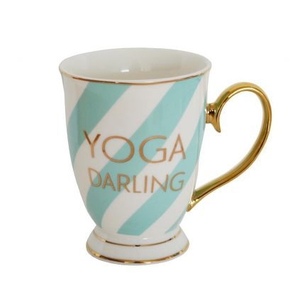 A luxurious mint and white fine china mug with golden details