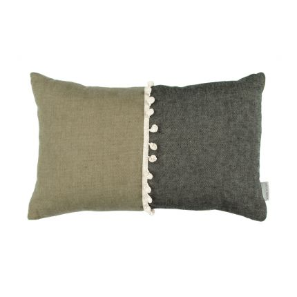 A luxurious two-toned linen cushion with bobble details