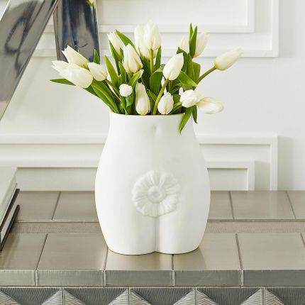 A luxurious white porcelain vase inspired by the human form