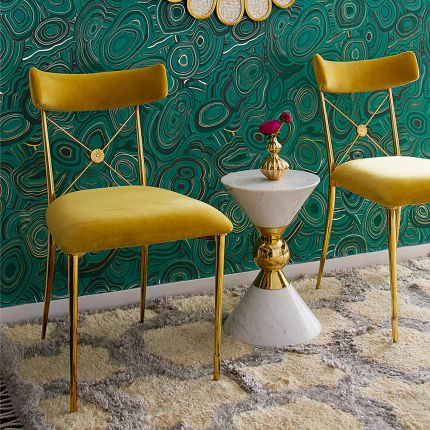 A luxurious vintage style dining chair with polished brass accents