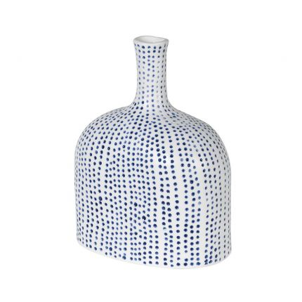 A luxurious white ceramic and blue polka dot abstract vase